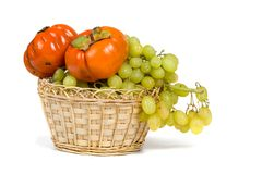Ripe persimmons and grapes Stock Photo