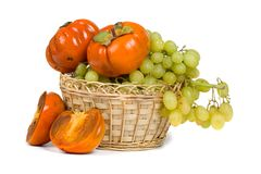 Ripe persimmons and grapes Royalty Free Stock Photography