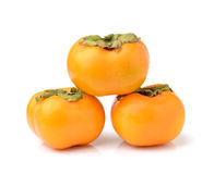 Ripe persimmons isolated on white background Royalty Free Stock Image