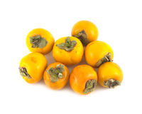 Ripe persimmons isolated on white Royalty Free Stock Photo