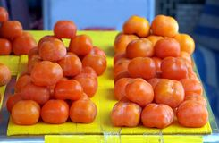 Ripe Persimmons for Sale at the Market Royalty Free Stock Image