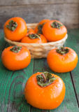 Ripe persimmons in a wicker basket Royalty Free Stock Photo