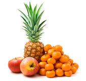 Ripe  pineapple, apples and tangerines. Pineapple, apples and tangerines isolated on a white background Royalty Free Stock Photography