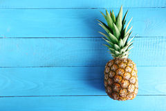 Ripe pineapple. On a blue wooden table Stock Photography