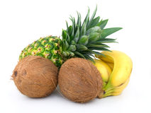 Ripe pineapple, bunch of bananas and coconut Royalty Free Stock Photography
