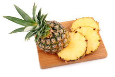 Ripe pineapple fruit with slices isolated Stock Photography