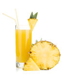 Ripe pineapple and juice glass Stock Images