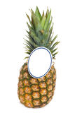Ripe pineapple with a paper price tag. Stock Image
