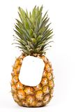 Ripe pineapple with a price tag Royalty Free Stock Photos