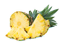 Ripe pineapple with slices  isolated on white Royalty Free Stock Photo