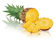 Ripe pineapple with slices isolated on white background. Royalty Free Stock Images
