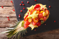 Ripe pineapple stuffed with fresh tropical fruits close-up. Hori Royalty Free Stock Photos
