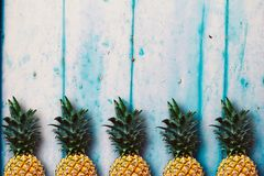 Ripe pineapples over the blue wooden table. stock photos