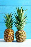 Ripe pineapples. On a white wooden table Stock Photo
