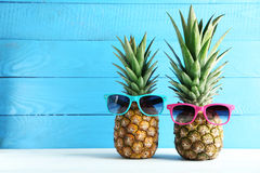 Ripe pineapples. On a white wooden table Stock Photos