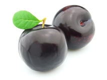 Ripe plum. Ripe sweet plum with leaves Royalty Free Stock Photo