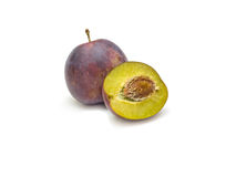 Ripe plum with bone Royalty Free Stock Image