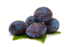 Ripe plum on the green leaves Royalty Free Stock Image