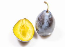 Ripe plum and half. On white background Royalty Free Stock Image