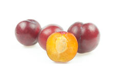 Ripe plum with slice. On white background Stock Images