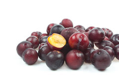 Ripe plum with slice. On  white background Royalty Free Stock Image