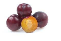 Ripe plum with slice. On white background Stock Photos