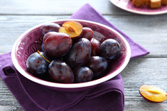 Ripe plum  in a small bowl Stock Images