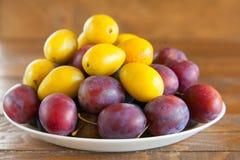 Ripe plum on table Stock Photos