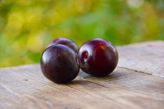Ripe plum on table Royalty Free Stock Image