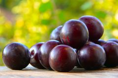 Ripe plum on table Stock Photos
