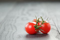 Ripe plum tomatoes on wood table Stock Photo