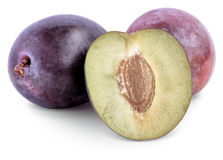 Ripe plum   on white background. With clipping paths Royalty Free Stock Photos