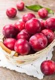 Ripe plum in a wicker basket Stock Photos