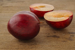 Ripe plum on wood Royalty Free Stock Images
