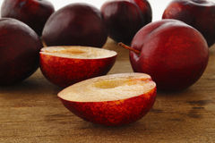 Ripe plum on wood Stock Image
