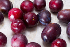 Ripe plums and cherry-plum on a table Stock Photos