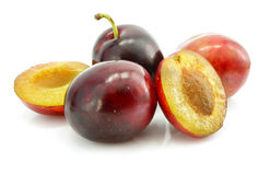 Ripe plums fruits with cut isolated Stock Photography