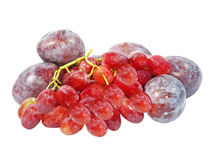Ripe plums and grape.Isolated. Royalty Free Stock Image