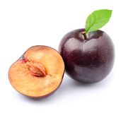 Ripe plums with leaves Stock Image