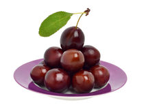 Ripe plums on the plate Royalty Free Stock Photo