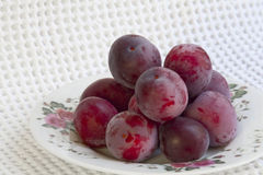 Ripe plums on a plate Royalty Free Stock Image