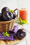 Ripe plums and plum juice Stock Photo