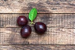 Ripe plums on table Stock Images
