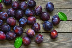 Ripe plums on table Royalty Free Stock Images