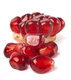 Ripe pomegranate. Piece  on white background Stock Photos