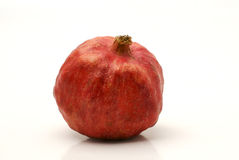 Ripe pomegranate. On a white background Royalty Free Stock Photos