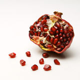 Ripe pomegranate. On a white background Royalty Free Stock Photo