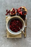 Fresh ripe pomegranate. Ripe pomegranate in bowl and knife flat lay - Image stock photography
