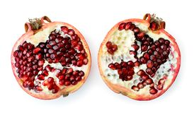Ripe pomegranate broken into two halves on a white. The form of the top. Ripe pomegranate broken into two halves on a white background. The form of the top stock image