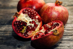 Ripe pomegranate fruit cut in half Royalty Free Stock Image